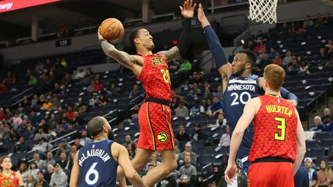 <p>               Atlanta Hawks' John Collins, center left, goes up for a shot as Minnesota Timberwolves' Josh Okogie of Nigeria defends in the second half of an NBA basketball game Wednesday, Feb. 5, 2020, in Minneapolis. The Hawks won 127-120. Collins scored 27 points and had 12 rebounds. Okogie scored 23 points for the Timberwolves. (AP Photo/Jim Mone)             </p>