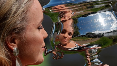 <p>               Sofia Kenin of the U.S. holds the Daphne Akhurst Memorial Cup at a photo shoot on the Yarra River following her win over Spain's Garbine Muguruza in women's singles final of the Australian Open tennis championship in Melbourne, Australia, Sunday, Feb. 2, 2020.  (AP Photo/Lee Jin-man)             </p>