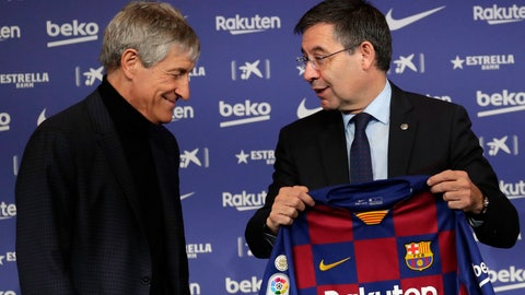 <p>               Soccer coach Quique Setien smiles with FC Barcelona's President Josep Maria Bartomeu, right, while being officially introduced as the club's new coach at the Camp Nou stadium in Barcelona, Spain, Tuesday, Jan. 14, 2020. Barcelona made a rare coaching change midway through the season, replacing Ernesto Valverde with former Real Betis manager Quique Setien on Monday. (AP Photo/Emilio Morenatti)             </p>
