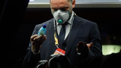 <p>               A Bulgarian soccer team Ludogorets staffer disinfects his hands on a coach bus heading to the San Siro stadium Milan, Italy, Thursday, Feb. 27, 2020. Ludogorets is playing Italian club Inter Milan in a Europa League soccer match on Thursday that is scheduled to go ahead in an empty stadium due to the coronavirus outbreak. (AP Photo/Luca Bruno)             </p>