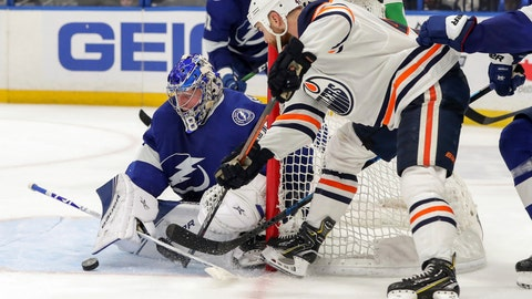 <p>               Tampa Bay Lightning goaltender Andrei Vasilevskiy, of Russia, makes a save against Edmonton Oilers' Zack Kassian during the third period of an NHL hockey game Thursday, Feb. 13, 2020, in Tampa, Fla. The Lightning won 3-1. (AP Photo/Mike Carlson)             </p>