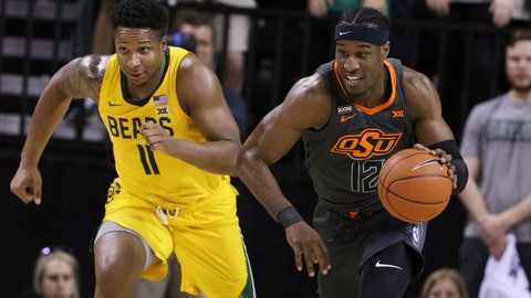 <p>               Oklahoma State forward Cameron McGriff, right, heads upcourt past Baylor guard Mark Vital, left, after a turnover during the first half of an NCAA college basketball game Saturday, Feb. 8, 2020, in Waco, Texas. (AP Photo/Rod Aydelotte)             </p>