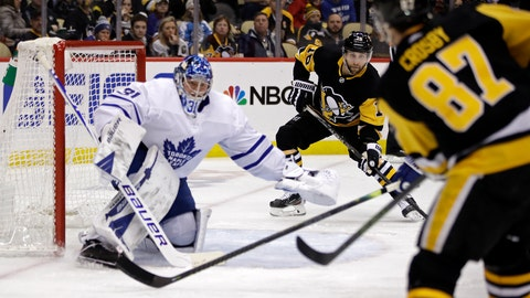 <p>               Pittsburgh Penguins' Sidney Crosby (87) passes to Jason Zucker (16) who put a shot behind Toronto Maple Leafs goaltender Frederik Andersen (31) for a goal during the second period of an NHL hockey game in Pittsburgh, Tuesday, Feb. 18, 2020. (AP Photo/Gene J. Puskar)             </p>