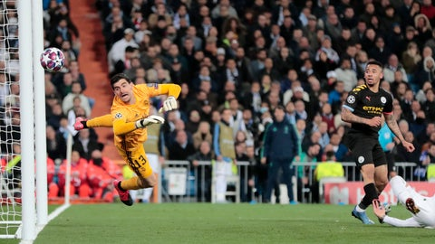 <p>               Manchester City's Gabriel Jesus, right, scores his side's first goal during the round of 16 first leg Champions League soccer match between Real Madrid and Manchester City at the Santiago Bernabeu stadium in Madrid, Spain, Wednesday, Feb. 26, 2020. (AP Photo/Bernat Armangue)             </p>