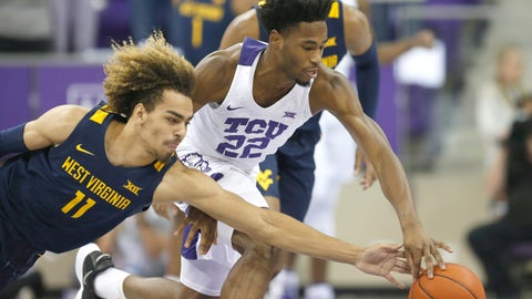 <p>               West Virginia forward Emmitt Matthews (11) attempts to steal the ball from TCU guard RJ Nembhard (22) during the first half of an NCAA college basketball game, Saturday, Feb. 22, 2020 in Fort Worth, Texas. (AP Photo/Ron Jenkins)             </p>