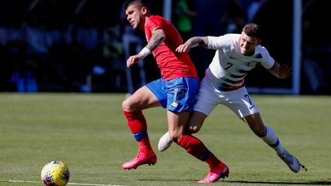 <p>               Costa Rica midfielder Ulises Segura (12) and United States forward Paul Arriola (7) vie for the ball during the first half of an international friendly soccer match in Carson, Calif., Saturday, Feb. 1, 2020. (AP Photo/Ringo H.W. Chiu)             </p>