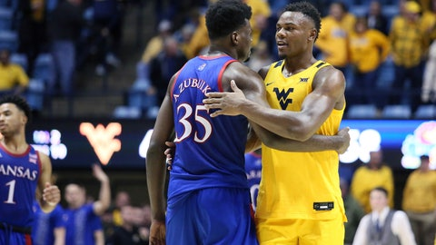 <p>               Kansas center Udoka Azubuike (35) and West Virginia forward Oscar Tshiebwe (34) greet each other after an NCAA college basketball game Wednesday, Feb. 12, 2020, in Morgantown, W.Va. (AP Photo/Kathleen Batten)             </p>