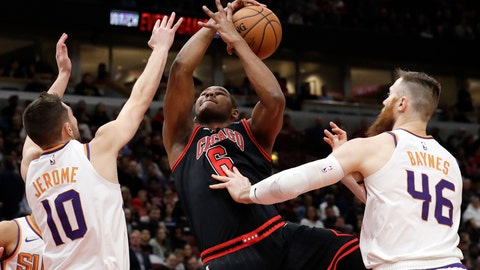 <p>               Chicago Bulls forward/center Cristiano Felicio, center, rebounds a ball against Phoenix Suns guard Ty Jerome, left, and center Aron Baynes during the first half of an NBA basketball game in Chicago, Saturday, Feb. 22, 2020. (AP Photo/Nam Y. Huh)             </p>