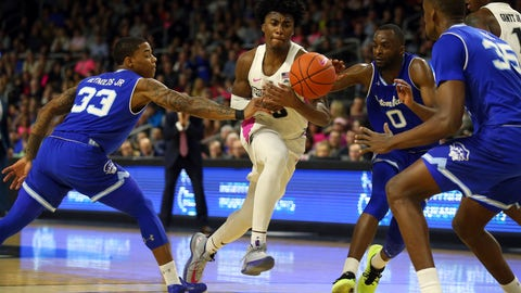 <p>               Providence's David Duke (3) has the ball knocked from his hands by the defense of Seton Hall's Shavar Reynolds, Jr. (33) and Quincy McKnight (0) during the second half of an NCAA college basketball game Saturday, Feb. 15, 2020, in Providence, R.I. (AP Photo/Stew Milne)             </p>