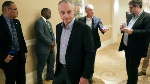 <p>               MLB Commissioner Rob Manfred, center, leaves a press conference during MLB baseball owners meetings, Thursday, Feb. 6, 2020, in Orlando, Fla. (AP Photo/John Raoux)             </p>
