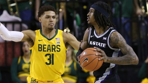 Kansas State guard Cartier Diarra (2) looks to pass the ball against Baylor guard MaCio Teague (31) in the second half of an NCAA college basketball game, Tuesday, Feb. 25, 2020, in Waco, Texas. (AP Photo/ Jerry Larson)