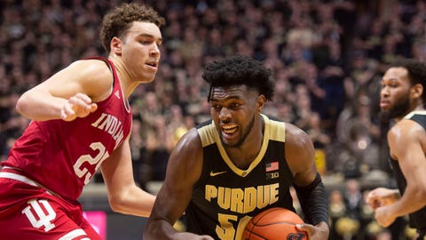 Feb 27, 2020; West Lafayette, Indiana, USA;  Purdue Boilermakers forward Trevon Williams (50) goes by Indiana Hoosiers forward Race Thompson (25) at  Mackey Arena. Mandatory Credit: Thomas J. Russo-USA TODAY Sports