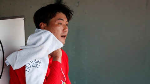 St. Louis Cardinals pitcher Kwang-Hyun Kim towels off in the dugout before starting a spring training baseball game against the Miami Marlins Wednesday, Feb. 26, 2020, in Jupiter, Fla. (AP Photo/Jeff Roberson)