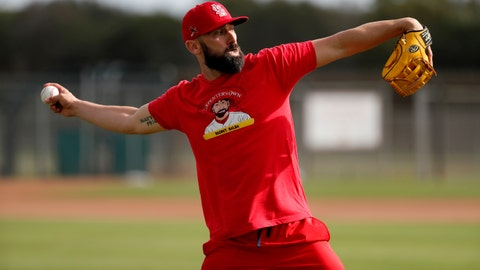 St. Louis Cardinals infielder Matt Carpenter throws during spring training baseball practice Wednesday, Feb. 12, 2020, in Jupiter, Fla. (AP Photo/Jeff Roberson)