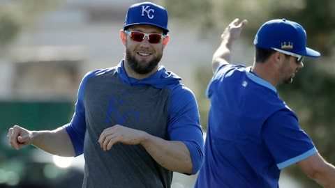 Kansas City Royals' Alex Gordon, left, and Whit Merrifield stretch during spring training baseball practice Monday, Feb. 17, 2020, in Surprise, Ariz. (AP Photo/Charlie Riedel)