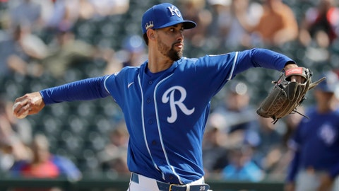 Kansas City Royals starting pitcher Jorge Lopez throws during the second inning of a spring training baseball game against the Texas Rangers Friday, Feb. 21, 2020, in Surprise, Ariz. (AP Photo/Charlie Riedel)
