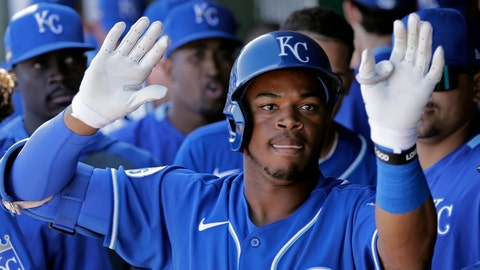 Kansas City Royals' Khalil Lee celebrates in the dugout after hitting a solo home run during the third inning of a spring training baseball game against the San Diego Padres Monday, Feb. 24, 2020, in Surprise, Ariz. (AP Photo/Charlie Riedel)