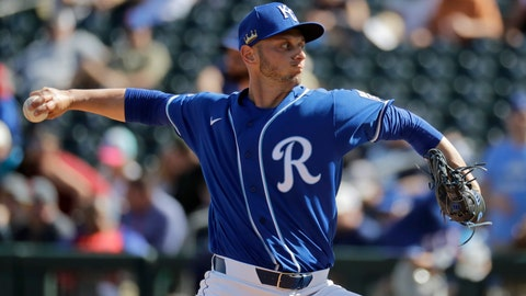 Kansas City Royals relief pitcher Stephen Woods Jr. throws during the third inning of a spring training baseball game against the Texas Rangers Friday, Feb. 21, 2020, in Surprise, Ariz. (AP Photo/Charlie Riedel)