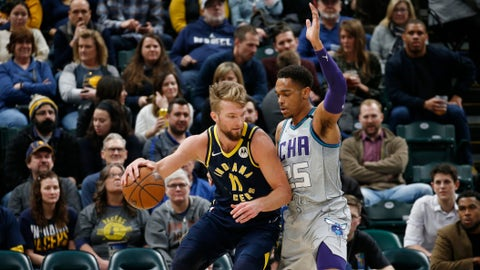 Feb 25, 2020; Indianapolis, Indiana, USA; Indiana Pacers forward Domantas Sabonis (11) is guarded by Charlotte Hornets forward P.J. Washington (25) during the first quarter at Bankers Life Fieldhouse. Mandatory Credit: Brian Spurlock-USA TODAY Sports