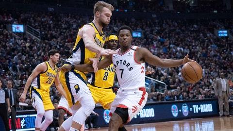 Feb 23, 2020; Toronto, Ontario, CAN; Toronto Raptors guard Kyle Lowry (7) controls a ball as Indiana Pacers forward Domantas Sabonis (11) defends during the second quarter at Scotiabank Arena. Mandatory Credit: Nick Turchiaro-USA TODAY Sports
