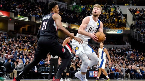 Indiana Pacers forward Domantas Sabonis (11) looks to shoot over Portland Trail Blazers center Hassan Whiteside (21) during the second half of an NBA basketball game in Indianapolis, Thursday, Feb. 27, 2020. (AP Photo/AJ Mast)