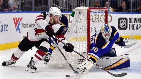 Feb 20, 2020; St. Louis, Missouri, USA;  St. Louis Blues goaltender Jordan Binnington (50) defends the net against Arizona Coyotes left wing Taylor Hall (91) during the first period at Enterprise Center. Mandatory Credit: Jeff Curry-USA TODAY Sports