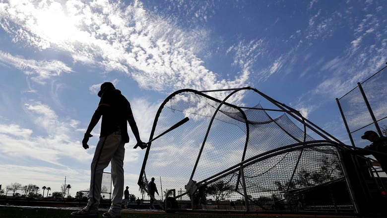 MLB encourages players to leave spring training facilities, return home