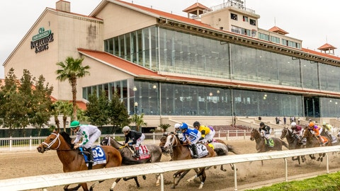 <p>               Wells Bayou, left, ridden by jockey Florent Geroux, took an early lead and held off NY Traffic to win he 107th running of the $1,000,000 Grade II Louisiana Derby horse race, Saturday, March 21, 2020, at a fanless Fair Grounds race course in New Orleans.  (Amanda Hodges Weir/Hodges Photography, Fair Grounds Race Course via AP)             </p>