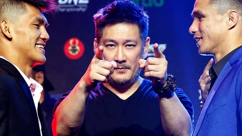 <p>               FILE - In this  July 30, 2019, file photo, One Championship founder Chatri Sityodtong, center, gestures as Reece McLaren, right, of Australia and Danny Kingad, of the Philippines face off during the media presentation for this ONE Championship mixed martial arts fight dubbed: Dawn of Heroes, in suburban Pasay city, south of Manila, Philippines. As his mixed martial arts promotions go behind closed doors and audience free, Sityodtong says he's finding ways to thrive during the coronavirus pandemic that is shutting down sports around the globe.  (AP Photo/Bullit Marquez, File)             </p>