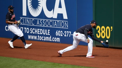 <p>               Cleveland Indians right fielder Domingo Santana, right, chases down a double hit by Los Angeles Dodgers' Tyler White as Indians center fielder Delino DeShields, left, watches during the fourth inning of a spring training baseball game Thursday, Feb. 27, 2020, in Goodyear, Ariz. (AP Photo/Ross D. Franklin)             </p>
