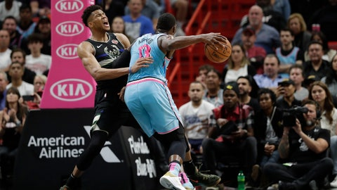 <p>               Miami Heat forward Bam Adebayo (13) fouls Milwaukee Bucks forward Giannis Antetokounmpo while going to shoot during the second half of an NBA basketball game, Monday, March 2, 2020, in Miami. (AP Photo/Wilfredo Lee)             </p>