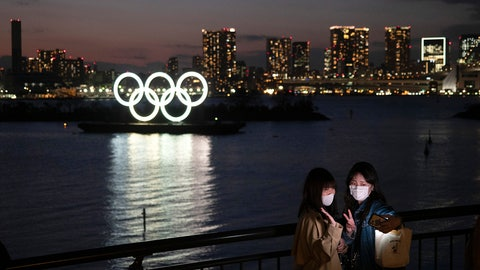 <p>               Two women take a selfie with the Olympic rings in the background in the Odaiba section of Tokyo, Thursday, March 12, 2020.  Doping testers around the sporting world are trying to avoid infecting themselves or athletes during the global virus outbreak, and that's not easy when collecting samples means getting very close to sports stars. (AP Photo/Jae C. Hong)             </p>