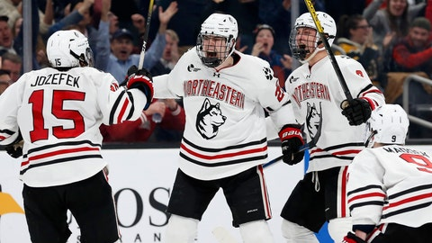 <p>               Northeastern's Patrick Schule (25) celebrates his goal with teammates Grant Jozefek (15), Julian Kislin (8) and Tyler Madden (9) during the second period of the Beanpot Tournament championship NCAA college hockey game against Boston University in Boston, Monday, Feb. 10, 2020. (AP Photo/Michael Dwyer)             </p>