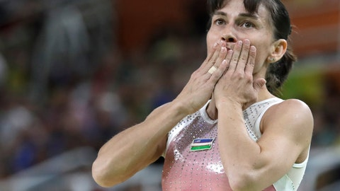 """<p>               FILE - In this Sunday, Aug. 7, 2016 file photo, Uzbekistan's Oksana Chusovitina acknowledges the audience after her routine on the balance beam during the artistic gymnastics women's qualification at the 2016 Summer Olympics in Rio de Janeiro, Brazil. Chusovitina had considered retirement before but chose to carry on before qualifying for her eighth Olympics — breaking her own record in the sport. This time around, the 1992 gold medalist said Tokyo will be her last Olympics. """"It's already good that they have postponed. Everything will calm down and everything will be fine, and I think then the Olympics will go ahead as normal,"""" said the 44-year-old Chusovitina, who is training in restricted. (AP Photo/Rebecca Blackwell, file)             </p>"""