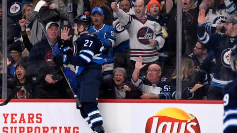 <p>               Winnipeg Jets' Nikolaj Ehlers (27) celebrates his goal against the Arizona Coyotes during second-period NHL hockey game action in Winnipeg, Manitoba, Monday, March 9, 2020. (Fred Greenslade/The Canadian Press via AP)             </p>