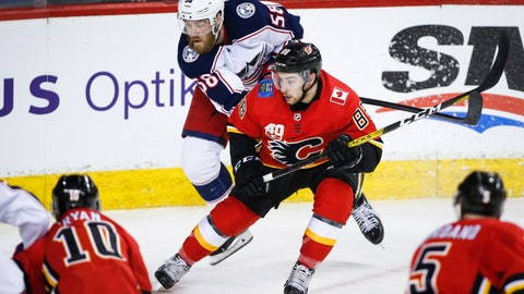 <p>               Columbus Blue Jackets' David Savard, , left, scrambles to get past Calgary Flames' Andrew Mangiapane during the second period of an NHL hockey game, Wednesday, March 4, 2020 in Calgary, Alberta. (Jeff McIntosh/The Canadian Press via AP)             </p>