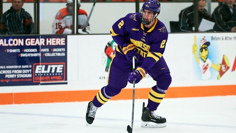 <p>               FILE - In this Dec. 15, 2018, file photo, Minnesota State defenseman Connor Mackey (2) skates with the puck against the Bowling Green during an NCAA college hockey game in Bowling Green, Ohio. Mackey, a top college free agent, signed with the Calgary Flames last week.  (AP Photo/Rick Osentoski, File)             </p>