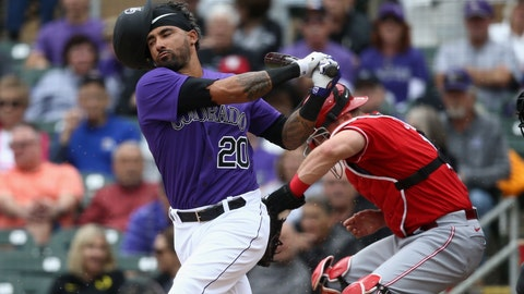 <p>               Colorado Rockies' Ian Desmond (20) loses his helmet on a swing as Cincinnati Reds catcher Curt Casali, right, gets out of the way during the second inning of a spring training baseball game Tuesday, March 10, 2020, in Scottsdale, Ariz. (AP Photo/Ross D. Franklin)             </p>