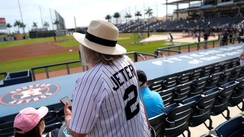 <p>               A woman wears a Derek Jeter as she settles into her seat prior to a spring training baseball game between the New York Yankees and the Washington Nationals, Thursday, March 12, 2020, in West Palm Beach, Fla. (AP Photo/Julio Cortez)             </p>