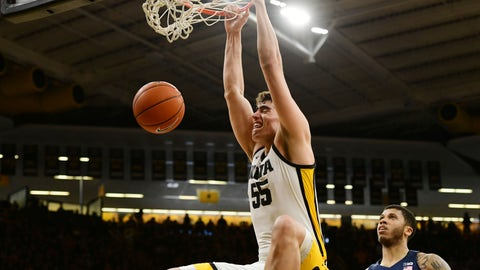 <p>               Iowa's Luka Garza (55) dunks the ball as Penn State's Myles Dread (2) looks on during the second half of an NCAA college basketball game, Saturday, Feb. 29, 2020, in Iowa City, Iowa. (AP Photo/Cliff Jette)             </p>