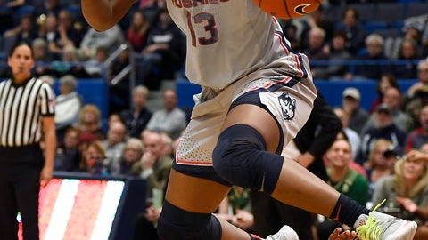 <p>               Connecticut's Christyn Williams (13) jumps over South Florida's Sydni Harvey in the first half of an NCAA college basketball game, Monday, March 2, 2020, in Hartford, Conn. (AP Photo/Jessica Hill)             </p>