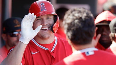 <p>               FILE - In this Feb. 25, 2020, file photo, Los Angeles Angels' Mike Trout smiles after scoring during the first inning of a spring training baseball game against the Cincinnati Reds, in Tempe, Ariz. Mike Trout hit two home runs off Zack Greinke and scored four times to help the Los Angeles Angels beat the Houston Astros 9-6 on opening day.  Alas, the game was played on a computer, not on the field. But as fans of the Strat-O-Matic board game can attest, make-believe box scores can be fun too. (AP Photo/Darron Cummings, File)             </p>