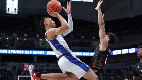 <p>               Pittsburgh's Trey McGowens, left, shoots as Miami's Isaiah Wong, right, defends during the first half of an NCAA college basketball game, Sunday, Feb. 2, 2020, in Pittsburgh. (AP Photo/Keith Srakocic)             </p>