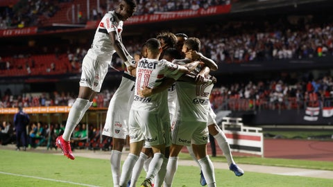 <p>               Players of Brazil's Sao Paulo celebrate their side's 3rd goal scored by teammate Igor Gomes during a Copa Libertadores soccer match against Ecuador's Liga Deportiva Universitaria in Sao Paulo, Brazil, Wednesday, March 11, 2020. (AP Photo/Andre Penner)             </p>