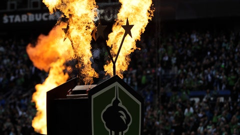 <p>               Fire effects go off behind two stars signifying the Seattle Sounders' two MLS Cup championship victories at the start of their season-opening MLS soccer match against the Chicago Fire, Sunday, March 1, 2020, in Seattle. The Sounders won the MLS Cup in 2016 and 2019. (AP Photo/Ted S. Warren)             </p>