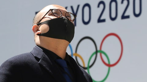 <p>               A man walks in front of a Tokyo Olympics logo at the Tokyo metropolitan government headquarters building in Tokyo, Wednesday, March 25, 2020. The Olympic torch relay was postponed Tuesday because the Tokyo Games themselves were pushed back to 2021. (AP Photo/Koji Sasahara)             </p>