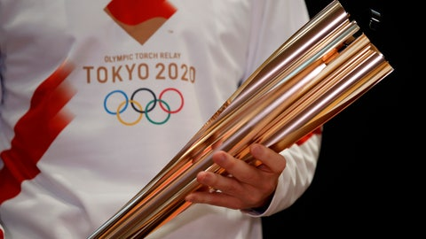<p>               Greek singer Sakis Rouvas wears the uniform of the torch relay runners as he holds the torch of the 2020 Tokyo Olympic Games during a presentation of the torch relay within in Greece, in Athens, Monday, Feb. 24, 2020. The Olympic flame lighting ceremony will be held on Thursday, March 12, and will burn at the July 24 - Aug. 9 Tokyo 2020 Olympics. (AP Photo/Thanassis Stavrakis)             </p>