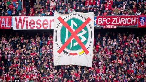 <p>               Visitors show a banner with the logo of the German Soccer Association (DFB) during the German Bundesliga soccer match between FC Bayern Munich and FC Augsburg in Munich, Germany, Saturday, March 7, 2020. Bundesliga games saw more widespread protests as fans vented their anger with the German soccer federation over the weekend. ( Sven Hoppe/dpa via AP)             </p>