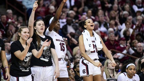 <p>               South Carolina forward Mikiah Herbert Harrigan, right, Laeticia Amihere (15), Elysa Wesolek and Olivia Thompson, left, react to a score during the second half of an NCAA college basketball game against Texas A&M, Sunday, March 1, 2020, in Columbia, S.C. (AP Photo/Sean Rayford)             </p>