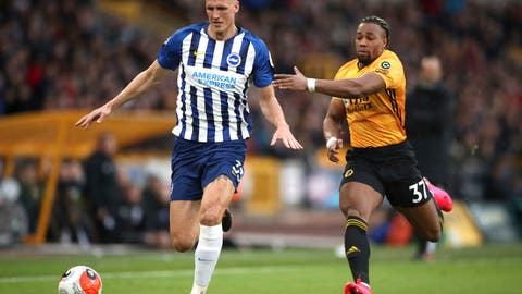 <p>               Brighton and Hove Albion's Dan Burn, left, and Wolverhampton Wanderers' Adama Traore battle for the ball during the English Premier League soccer match between the Wolverhampton Wanderers and Brighton and Hove Albion, at Molineux, in Wolverhampton, England, Saturday March 7, 2020. (Nick Potts/PA via AP)             </p>